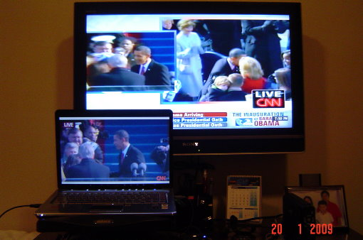 Watching Pres. Obama on cable TV and online.