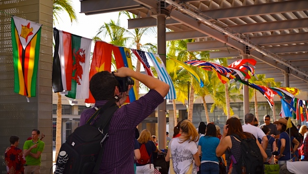 Capturing national banners at Discovery Square, while preparing for the start of the parade.