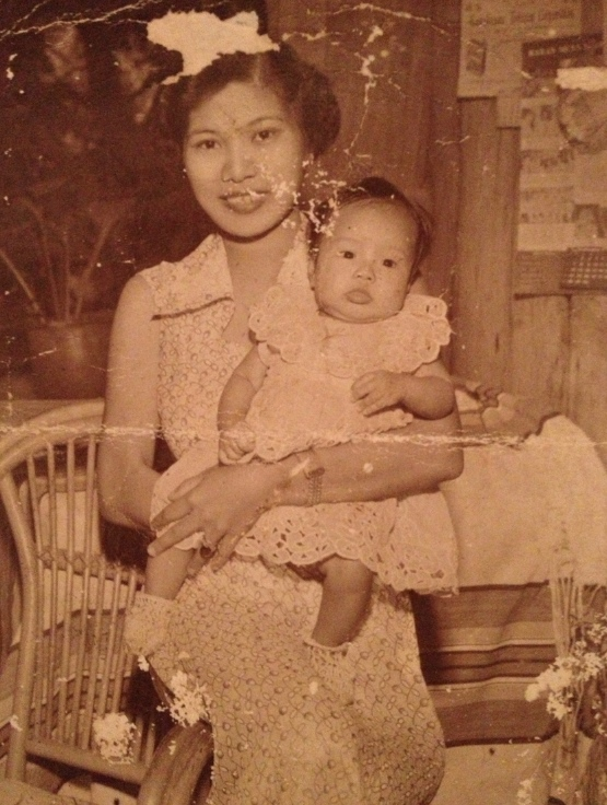 My mother Natividad G.  Ramos, with their first born (and our eldest sister) Elsa.