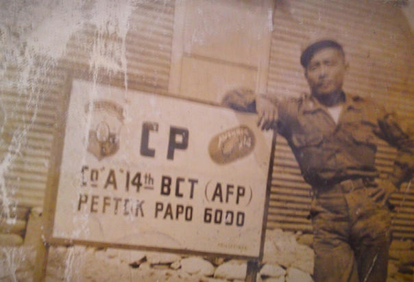 My battle-tested father posing for a souvenir photo at their camp in Korea.